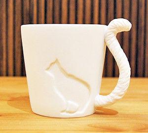 Cup mit einem Schwanz - Kätzchen