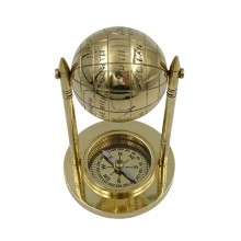 Brass compass with a globe