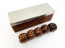 A game of dice in a wooden box with a metal top