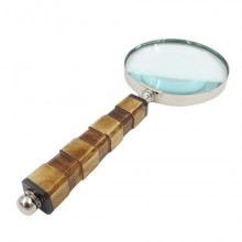 An exclusive brass magnifier with a bone handle