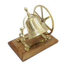 Rotating brass bell on a wooden base